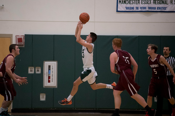SAM GORESH/Staff photo. Manchester-Essex sophomore William Janowicz leaps to shoot a basket in their game against Rockport at Manchester-Essex. 12/23/16