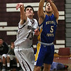 MIKE SPRINGER/Staff photo<br /> Rockport's Austin Matus, left, shoots the ball past Jacob Belanger of Whitinsville Friday during the 11th annual BankGloucester Holiday Tournament in Gloucester.<br /> 12/29/2017