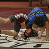 MIKE SPRINGER/Staff photo   <br /> Gloucester's Liam Donahue, left, competes in the 136-pound division with Matt Reidy of Danvers during a varsity wrestling match Wednesday in Gloucester.<br /> 12/20/2017