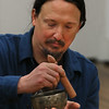 "MIKE SPRINGER/Staff photo   <br /> Justin Christopher of Rockport plays a Tibetan singing bowl during a rehearsal Monday for the Winter Solstice Celebration at the Floating Lotus in Gloucester. The event, which will be held on Thursday, the shortest day of the year and the beginning of winter, from 7 to 9 p.m., will include meditation accompanied by Tibetan gongs, bells and singing bowls, a candle-lighting ceremony and tribal dance. It is open to the public. Tickets are $25 and can be obtained at Floating Lotus at 169 Main Street or at  <a href=""http://www.floatinglotus.net"">http://www.floatinglotus.net</a>.<br /> 12/18/2017"