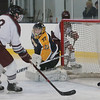 MIKE SPRINGER/Staff photo<br /> Rockport's Phillip Parker, left, watches as a shot by teammate Frew Rowen just misses going into the net during varsity hockey action Wednesday against Minuteman in Gloucester.<br /> 12/27/2017