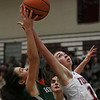 MIKE SPRINGER/Staff photo   <br /> Gloucester's Rachael Rallo, right, competes for a rebound with Grace Brennan of Manchester Essex during varsity basketball action Thursday in Gloucester.<br /> 12/28/2017