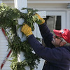 MIKE SPRINGER/Staff photo<br /> Nick Benn, co-owner of the Seven South Street Inn, decorates a sign in preparation for Rockport's second annual Twilight Inn and Cookie Tour, which will take place Saturday between 4 and 7 p.m. Besides the Seven South Street Inn, establishments participating in the event will include the Seafarer Inn on Marmion Way, Lantana House on Broadway, the Linden Tree Inn on King Street and the Emerson Inn on Cathedral Avenue.<br /> 12/08/17