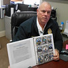 SEAN HORGAN/Staff photo/Essex police Chief Peter G. Silva talks about the department's rejuventated collectible card program. in his office.
