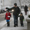 MIKE SPRINGER/Staff photo   <br /> Seth Barron of Acton and his children Joshua, 8, left, and Zachary, 3, stroll down Middle Street during the annual Middle Street walk on Saturday in Gloucester.<br /> 12/09/2017