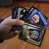MIKE SPRINGER/Staff photo<br /> A policeman holds a deck of Gloucester police trading cards Tuesday while distributing them to students at Plum Cove Elementary School.<br /> 12/07/2017