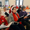 Rosie Reed, Dorothy Stoffa and Frances Fleming of the Dock Square Carolers practice inside the Rockport Baptist Church before the annual tree lighting on Saturday December 2, 2017 in Rockport, Ma.  Joseph Prezioso/Photo