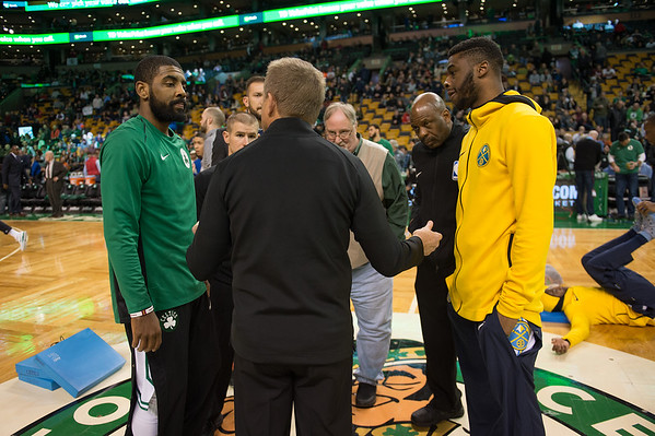 Desi Smith Photo.  Gloucester resident Stephen Tyler ,founder of To Show We Care, listens in ,as the teams captains meet at center court before the start of the game against the Denver Nuggets. Tyler was honored by the Boston Celtics organizaition Wednesday night at the TD Garden in Boston for the Heroes Among Us.  December 13,2017