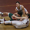 MIKE SPRINGER/Staff photo<br /> Gloucester's Brendan O'Brien, top, and Kenny Turner compete for a loose ball with Jackson Levendusky, center, of Manchester Essex during the 11th annual BankGloucester Holiday Tournament on Friday in Gloucester.<br /> 12/29/2017