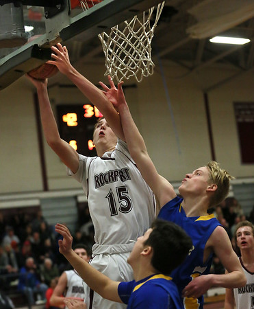 MIKE SPRINGER/Staff photo<br /> Rockport's Gavyn Hillier goes up for a layup against Whitinsville Friday during the 11th annual BankGloucester Holiday Tournament in Gloucester.<br /> 12/29/2017