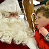 Santa greets Jack Harding, 4, in the Old Firehouse on Pleasant St. where the Clauses greeted children after arriving via lobster boat at the T-Wharf at Rockport Harbor for the annual parade and tree lighting on Saturday December 2, 2017 in Rockport, Ma.  Joseph Prezioso/Photo [[MER1712031143103500]]