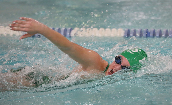 MIKE SPRINGER/Staff photo   <br /> Olivia Gado of Manchester Essex competes in the 100-yard freestyle event Tuesday against Hamilton-Wenham in Wenham.<br /> 12/19/2017