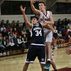 MIKE SPRINGER/Staff photo   <br /> Rockport's Gavyn Hillier, right, and Michael Moynihan of Hamilton-Wenham compete for a rebound during varsity basketball action Friday in Rockport.<br /> 12/22/2017