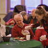 MIKE SPRINGER/Staff photo   <br /> Earl and Andrea Morgan of Manchester watch as Manchester Essex Regional High School senior Maggy Delisio pours more gravy during the annual senior citizens holiday luncheon Saturday at the school dining room in Manchester.<br /> 12/09/2017