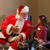 MIKE SPRINGER/Staff photo<br /> Four-year-old Cedella Miller talks with Santa Claus during a special storytime and sing-along Tuesday at the T.O.H.P. Burnham Library in Essex.<br /> 171219