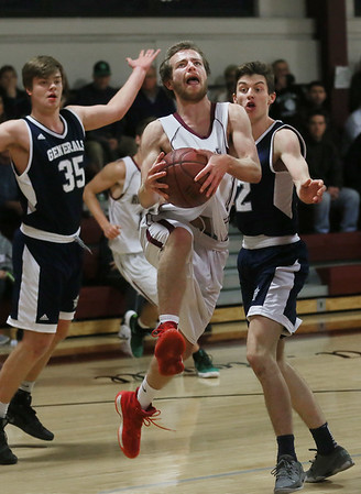 MIKE SPRINGER/Staff photo   <br /> Rockport's Quinn Murdock goes up for a basket as James Lustig, left, and Cam Grinnell of Hamilton-Wenham play defense during varsity basketball action Friday in Rockport.<br /> 12/22/2017