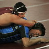 MIKE SPRINGER/Staff photo   <br /> Gloucester's Ryan Argento, left, competes in the 182-pound division with Russell Conova of Danvers during a varsity wrestling match Wednesday in Gloucester.<br /> 12/20/2017