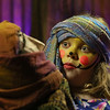 MIKE SPRINGER/Staff photo   <br /> Eight-year-old Isabella Bakinowski looks at a puppet while performing as an audience volunteer with Dora Tevan's World Family Puppet Theatre at the Old Firehouse Trust Building during the annual Rockport New Year's Eve celebration Sunday night in Rockport.<br /> 12/31/2017