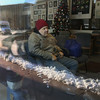 MIKE SPRINGER/Staff photo<br /> With snow and frigid temperatures just outside the window, Robert Newton watches television Thursday in the warmth of the Rose Baker Senior Center in Gloucester. The center is one of several designated warming places in the city.<br /> 12/28/2017
