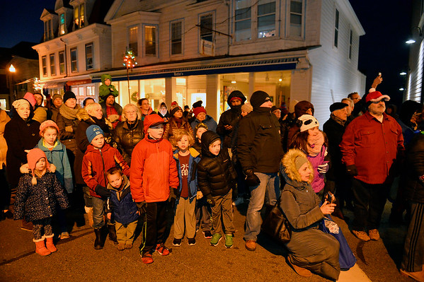 Families lined Main St., braving the cold night, to watch the Rockport Annual Christmas Pageant in Rockport on Saturday December 16, 2017.  JOSEPH PREZIOSO/Photo