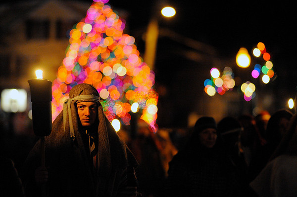 Ian Halpin, 19, is lit from the flame of his torch as he marches from Dock Square and up Main Street during the Annual Rockport Christmas Pageant on Saturday December 16, 2017.  JOSEPH PREZIOSO/Photo