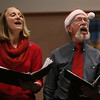 MIKE SPRINGER/Staff photo   <br /> Laura Franc of Foxboro and Keith Daniel of Warren, Rhode Island, sing a Christmas song with the a capella group Custom Blend at Trinity Congregational Church during the annual Middle Street walk on Saturday in Gloucester.<br /> 12/09/2017