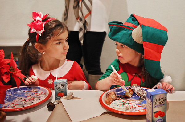 MIKE SPRINGER/Staff photo   <br /> Five-year-old Vanessa Tucker, left, and her friend Gia Brackett, 4, enjoy a holiday brunch on Friday at the Lighthouse Nursery School in Rockport. The children also sang holiday songs for their parents during the event.<br /> 12/22/2017