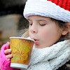 "Lilly Barry, 9, enjoys some hot coco on board the Lobster boat ""William G. Drohan"" where she hitched a ride with her family to help transport Santa to T-Wharf at Rockport Harbor for the annual parade and tree lighting on Saturday December 2, 2017 in Rockport, Ma.  Joseph Prezioso/Photo"