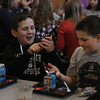 MIKE SPRINGER/Staff photo<br /> Fifth-graders Tyler LeClaire, left, and Michael Salafia look at their police trading cards Tuesday in the lunchroom at Plum Cove Elementary School.<br /> 12/07/2017