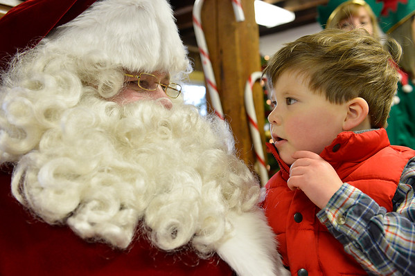 Santa greets Jack Harding, 4, in the Old Firehouse on Pleasant St. where the Clauses greeted children after arriving via lobster boat at the T-Wharf at Rockport Harbor for the annual parade and tree lighting on Saturday December 2, 2017 in Rockport, Ma.  Joseph Prezioso/Photo