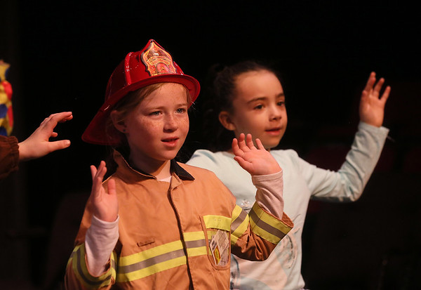 MIKE SPRINGER/Staff photo   <br /> Seven-year-old Claire Dullea, left, plays a fireman and 6-year-old Sophie LoGrasso plays a sheep in the annual Holiday Delights show presented by the Youth Acting Workshop at the Gloucester Stage.<br /> 12/09/2017