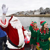 "Santa and his elves wave to hundreds gathered on shore from the Lobster boat ""William G. Drohan""  as he arrives at the T-Wharf at Rockport Harbor for the annual parade and tree lighting on Saturday December 2, 2017 in Rockport, Ma.  Joseph Prezioso/Photo"