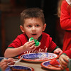 MIKE SPRINGER/Staff photo   <br /> Three-year-old Tyler O'Connell eats a Christmas cookie during a holiday brunch on Friday at the Lighthouse Nursery School in Rockport.<br /> 12/22/2017