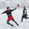 MIKE SPRINGER/Staff photo   <br /> The ball slips from the hand of Navy receiver Ryan Carvalho, an active U.S. Coast Guard member, as Army player David Elwell, a Gloucester firefighter, looks on during the first-ever Army-Navy flag football game for veterans Saturday at Newell Stadium in Gloucester<br /> 12/09/2017