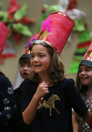 MIKE SPRINGER/Staff photo   <br /> Second-grader Emme Sabia performs Monday in a holiday concert at Plum Cove Elementary School.<br /> 12/18/2017