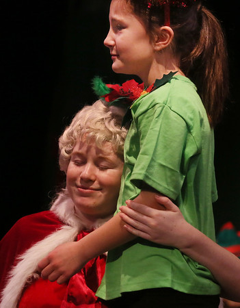 MIKE SPRINGER/Staff photo   <br /> Mrs. Claus, played by 15-year-old Meagan Gallo, hugs her favorite elf, Nice, played by 8-year-old Scarlet Lee, in the annual Holiday Delights show presented by the Youth Acting Workshop at the Gloucester Stage.<br /> 12/09/2017