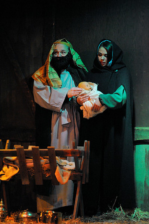 Joseph and Mary played by Jay Smith and Micaela Coonley, hold their baby Jesus at the Nativity scene at the First Unitarian Universalist Church during the Rockport Annual Christmas Pageant in Rockport on Saturday December 16, 2017.  JOSEPH PREZIOSO/Photo