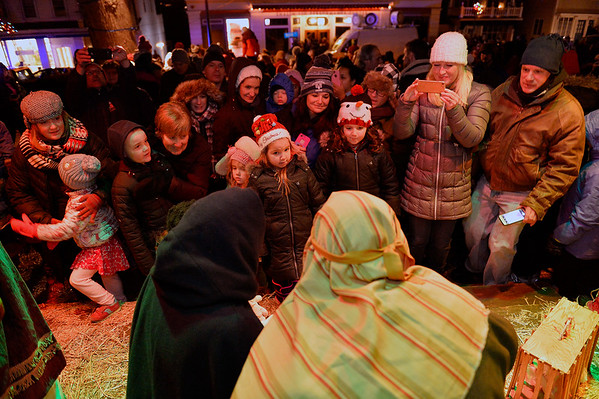 Children and families lined up to greet baby Jesus on the lawn of the First Unitarian Universalist Church's Nativity scene during the Rockport Annual Christmas Pageant in Rockport on Saturday December 16, 2017.  JOSEPH PREZIOSO/Photo