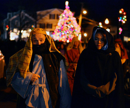 Joseph and Mary played by Jay Smith and Micaela Coonley, march up Main St. towards the Nativity scene at the First Unitarian Universalist Church at the Rockport Annual Christmas Pageant in Rockport on Saturday December 16, 2017.  JOSEPH PREZIOSO/Photo