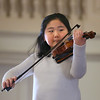 "MIKE SPRINGER/Staff photo   <br /> Nine-year-old Julia Kam plays ""Silent Night"" on the violin as she and 27 other children from the cast of the Gloucester Stage Company's ""Holiday Delights"" show performed Wednesday at Gloucester City Hall during a ceremony honoring Dick and Barbara Wilson with the 2017 Linzee Coolidge Philanthropy Award. <br /> 12/20/2017"