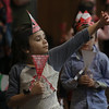 "MIKE SPRINGER/Staff photo   <br /> Kindergartner Lily-Lee Millner waves while walking in a ""Polygon Parade"" Wednesday at Beeman Elementary School in Gloucester. The event was organized as a fun way to review what the students have learned in geometry. Each class was assigned a different polygon -- a two-dimensional closed shape bounded by straight line segments -- and the students were asked to describe the the various forms their polygons can take. The kindergartners were assigned triangles.<br /> 12/20/2017"