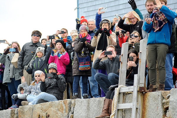 Hundreds gathered at T-Wharf at Rockport Harbor to greet Santa as he arrived via lobster boat for the annual parade and tree lighting on Saturday December 2, 2017 in Rockport, Ma.  Joseph Prezioso/Photo
