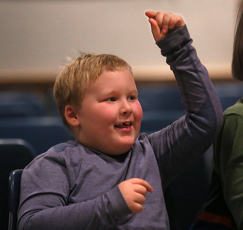 "MIKE SPRINGER/Staff photo   <br /> Six-year-old Aidan Hale enjoys a musical performance, ""Celebrating the Season, at the Rockport Public Library on Wednesday.<br /> 12/26/2017"