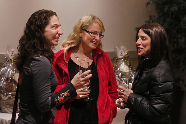 MIKE SPRINGER/Staff photo   <br /> From left, Enza Iacono of Gloucester, Sharon Els of Manchester and Lisa Novello of Gloucester enjoy wine and conversation Tuesday evening at the Savour wine and cheese shop on Prospect Street during the 44th annual Ladies Night in downtown Gloucester.<br /> 12/07/2017