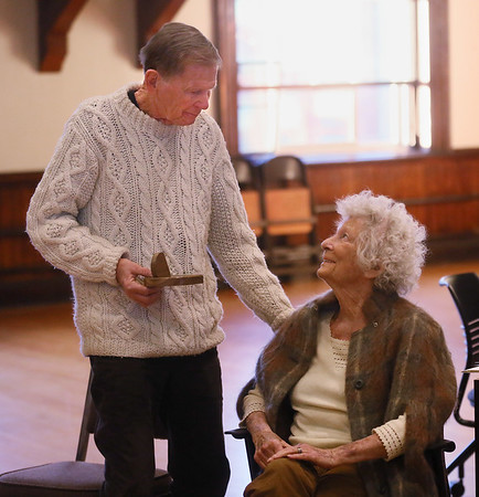 MIKE SPRINGER/Staff photo   <br /> Dick and Barbara Wilson look at each other moments after receiving the 2017 Linzee Coolidge Philanthropy Award during a ceremony Wednesday in the Kyrouz Auditorium at Gloucester City Hall. The auditorium was filled with people, as a series of speakers praised the Wilsons for their years of civic commitment.<br /> 12/20/2017