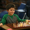 MIKE SPRINGER/Staff photo<br /> Second-grader Massimo Colarusso plays a match in the after-school chess club at Manchester Memorial School.<br /> 11/08/2017