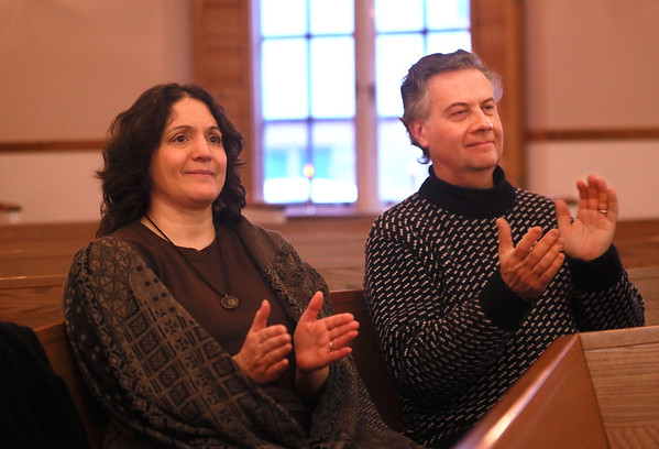 MIKE SPRINGER/Staff photo   <br /> Leslie Lobell and Eric Timsak, who have visited Gloucester from their home in Butler, New Jersey, every year for the past five years to attend the Middle Street Walk, applaud the Custom Blend vocal group during their concert Saturday at Trinity Congregational Church in Gloucester.<br /> 12/09/2017