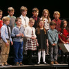 "MIKE SPRINGER/Staff photo<br /> Second graders from Essex Elementary School sing ""The Big Tornado,"" a song they wrote themselves under the tutelage of folk singer Daisy Nell, during the Manchester Essex Elementary School Holiday Concert on Tuesday evening at the Manchester Essex Regional Middle and High School auditorium. In addition to the second grade folk singers, the concert featured events from the fourth and fifth grade chorus and the fifth grade band.<br /> 12/19/2017"