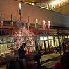 TIM JEAN/Staff photo<br /> <br /> Rabbi Stephen Lewis lead the crowd inprayer as they light the Lobsta Trap Menorah outside the Temple Ahavat Achim Tuesday night.     12/4/18