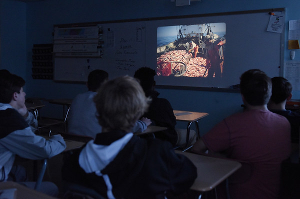TIM JEAN/Staff photo  Photos shown by Peter Ferrante, a longtime Gloucester fishrman, while giving a presentation to Kerry Herrmann's history class at Rockport High School.  12/11/18